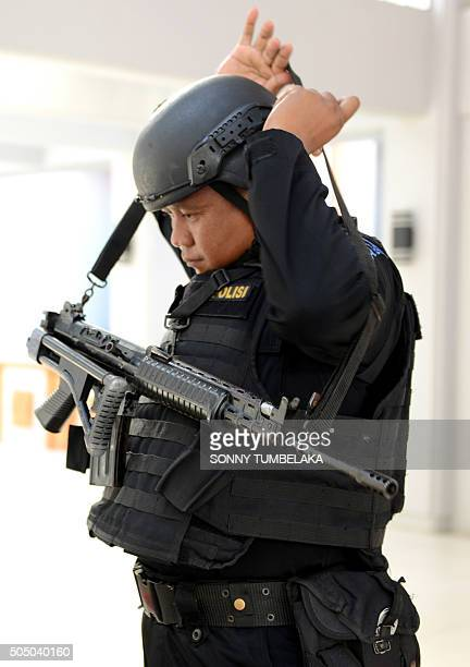 A member of the Indonesian Special Police patrols at Ngurah Rai Airport in Denpasar on Indonesia's resort island of Bali on January 15 one day after...