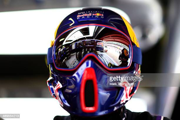A member of the Infiniti Red Bull Racing pit crew watches the action on the screens in the garage during the Spanish Formula One Grand Prix at...