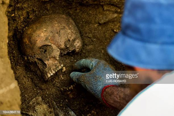 A member of the International Committee of the Red Cross works in the recovery of mortal remains of people killed by armed groups during the...