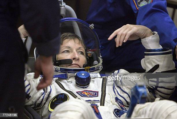 Member of the International space crew US Peggy Whitson has her space suite checked at the Baikonur cosmodrome in Kazakhstan 10 October 2007 The...