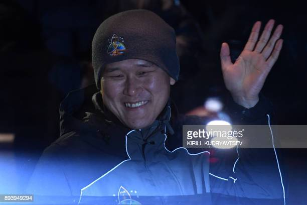 Member of the International Space Station expedition 53/54 Norishige Kanai of the Japan Aerospace Exploration Agency waves from a bus during a...