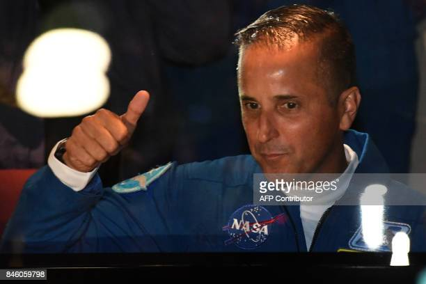 Member of the International Space Station expedition 53/54 US astronaut Joseph Akaba reacts near a bus during a sendingoff ceremony in the...