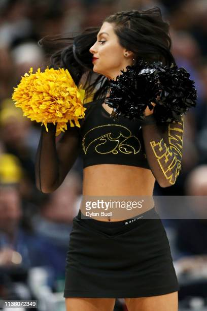 A member of the Iowa Hawkeyes dance team performs during the quarterfinals of the Big Ten Basketball Tournament at the United Center on March 15 2019...