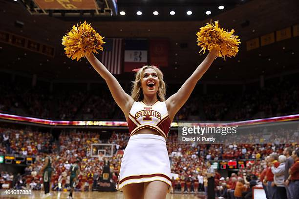 A member of the Iowa State Cyclones cheerleaders cheers on her team in the first half of play against the Baylor Bears at Hilton Coliseum on February...
