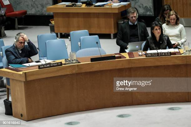 Member of the Iranian delegation Javad Safaei and US Ambassador to the United Nations Nikki Haley attend a UN Security Council meeting concerning the...