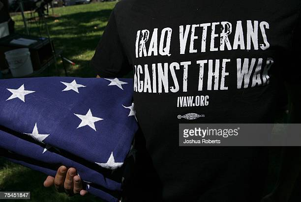 A member of the Iraq Veterans Against the War holds a US flag after a press conference at the US Capitol July 17 2007 in Washington DC Millard lead a...