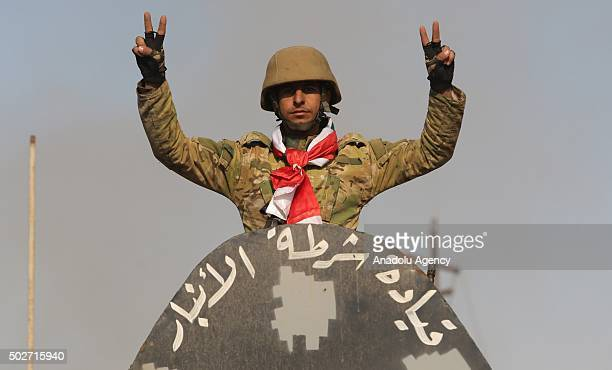 Member of the Iraqi security forces celebrates after retaking Ramadi city from Daesh in Ramadi Iraq on December 28 2015