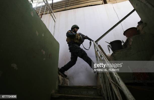 Member of the Iraqi security forces secures a building on the front line in Mosul's Old City on May 3 during an offensive to retake the city from...