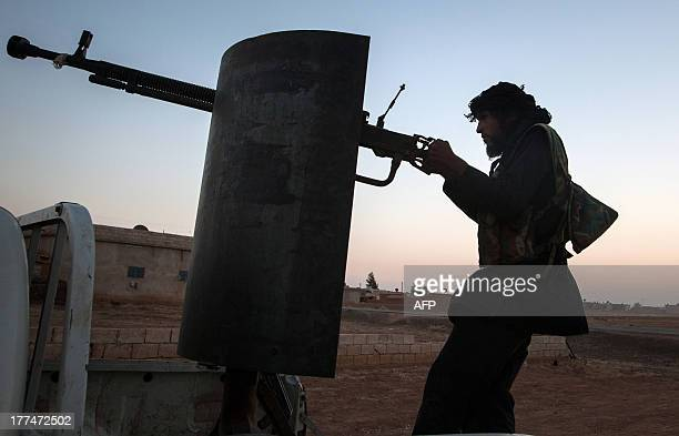 A member of the Islamic Kurdish Front aims at a position of fellow Kurdish fighters from the Committees for the Protection of the Kurdish People...