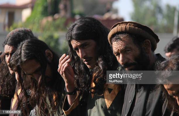Member of the Islamic state ISIS militants stand alongside their weapons, as they surrendered to government in Jalalabad, Nangarhar, Afghanistan on...