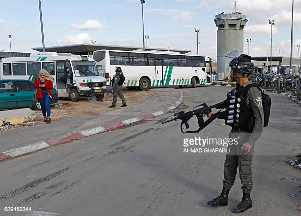 A member of the Israeli border police stands guard at the Qalandia checkpoint after a Palestinian woman made an attempted attack on Israeli security...