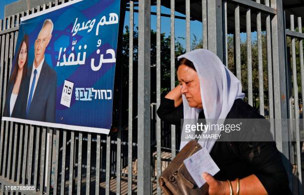 Member of the Israeli Druze community leaves after casting her vote during Israel's parliamentary elections on September 17 in Daliyat al-karmel in...