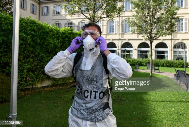 Member of the Italian army puts on protective gear prior to the disinfection in the nursing home on May 05, 2020 in Turin, Italy. Italy was the first...