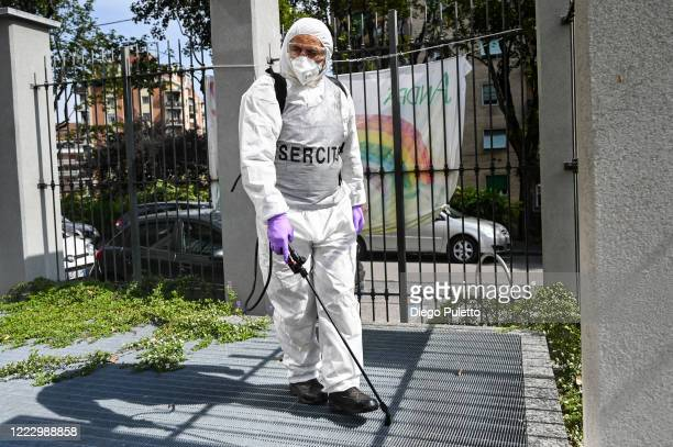Member of the Italian army wearing protective gear disinfects a nursing home on May 05, 2020 in Turin, Italy. Italy was the first country to impose a...