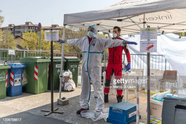 A member of the Italian Red Cross carries out sanitation procedures at the end of his round of home visits to COVID19 positive patients on April 3...