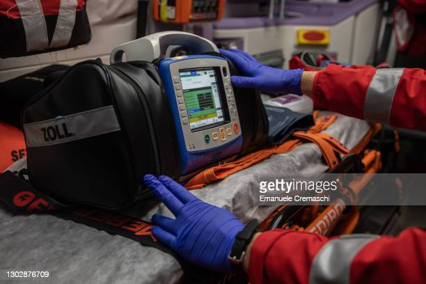 Member of the Italian Red Cross checks medical equipment on board an ambulance before his night shift on February 18, 2021 in Bergamo, Italy. The...