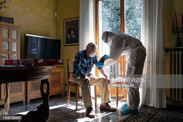 A member of the Italian Red Cross visits a patient during his round of home visits to COVID19 positive patients on April 3 2020 in Bergamo Italy The...
