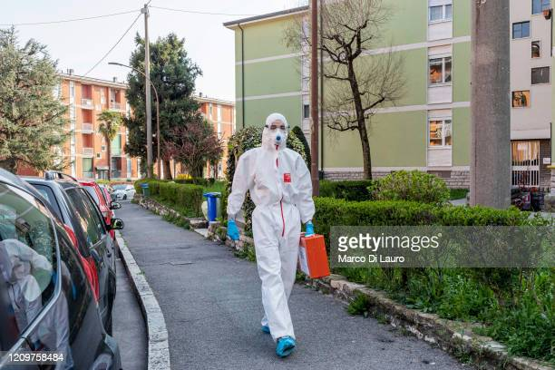 A member of the Italian Red Cross walks the street during his round of home visits to COVID19 positive patients on April 3 2020 in Bergamo Italy The...