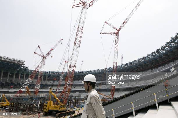 A member of the Japan Sports Council tours the construction site of the New National Stadium the main venue for the Tokyo 2020 Olympic and Paralympic...
