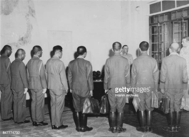 Member of the Japanese delegation presents their credentials to American Lieutenant General Richard K Sutherland at General MacArthur's headquarters...