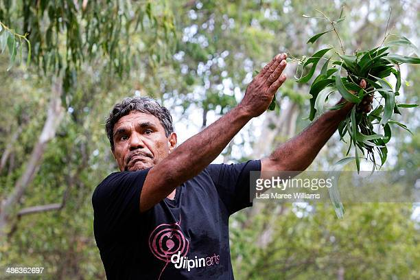 A member of the Jawoyn Mob welcomes passengers of the Ghan ANZAC Tribute train with traditional dancing at Nitmiluk National Park on April 23 2014 in...
