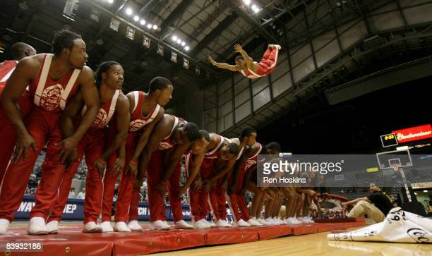 A member of the Jesse White Tumbling Team leaps over his teammates as they performed at halftime of the Iowa Energy and Fort Wayne Mad Ants game at...