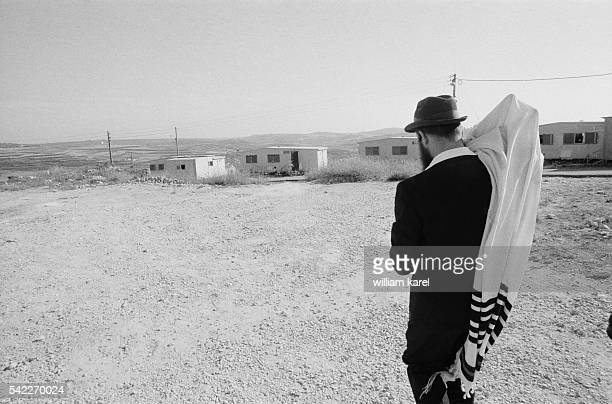 A member of the Jewish religious community from the Kadoumin settlement near Nablus holds a Torah covered by a tallith Many members of this community...
