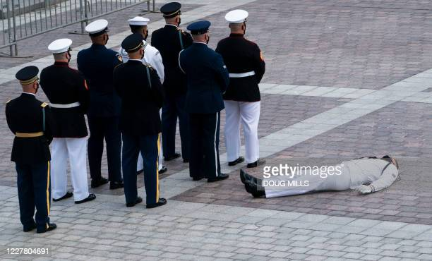 Member of the joint services military honor guard collapsed in the heat before carrying the flag-draped casket of US congressman and civil rights...