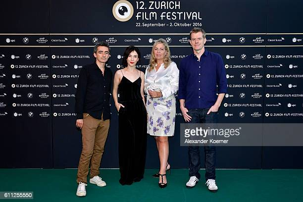 Member of the jury for international movie David Farr Sibel Kekilli president of the jury Lone Scherfig and Graham Broadbent pose for photographs at...