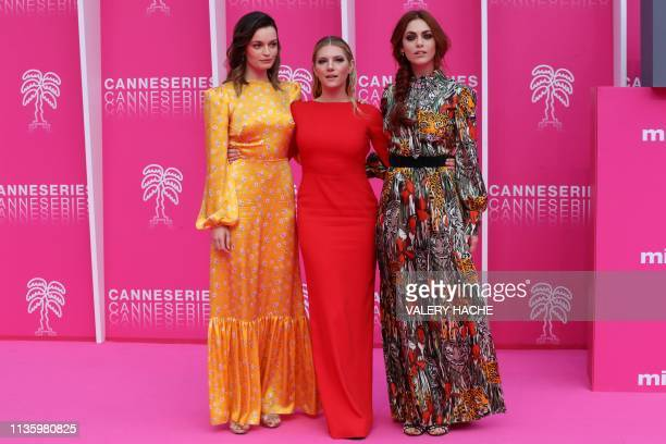 Member of the jury FrenchBritish actress Emma Mackey Canadian actress Katheryn Winnick and Italian actress Miriam Leone pose during the 2019 Cannes...