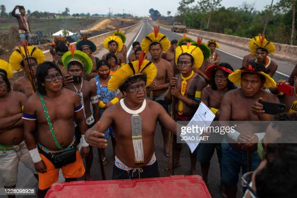 Member of the Kayapo indigenous tribe holds a request given by a judicial officer asking them to clear the highway BR163 within 24 hours, during a...