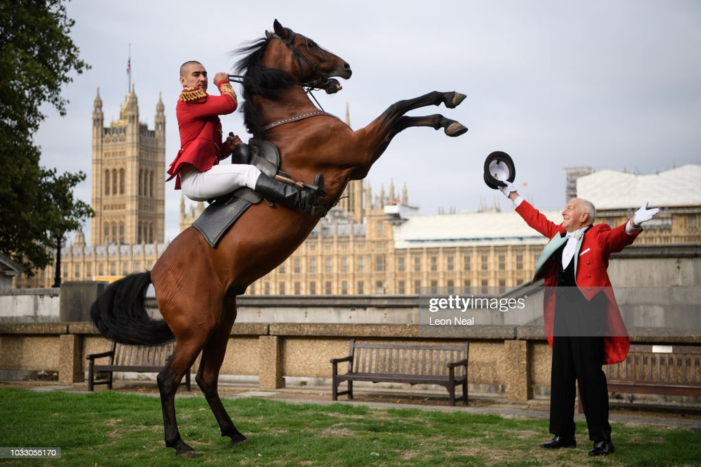 A member of the Khadikov Cossack Riders performs a trick as Zippo's Circus Ringmaster Norman Barrett looks on, following the unveiling of a stone plaque, celebrating 250 years of the circus, on September 14, 2018 in London, England. A commemorative flagstone was unveiled on the site of the first Amphitheatre to mark the 250th anniversary since the creation of what we today recognise as the circus. Created by Master Horseman Astley, the circus, in the grounds of what is now St Thomas Hospital, Lambeth, ran for 120 years.