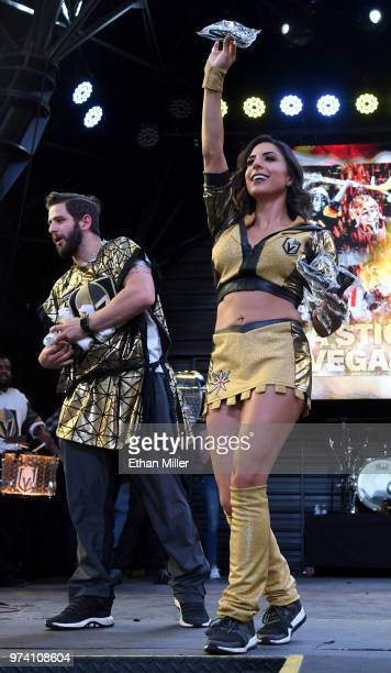 A member of the Knights Crew and a member of the Vegas Golden Knights Golden Aces throw Tshirts to fans during the team's 'Stick Salute to Vegas and...