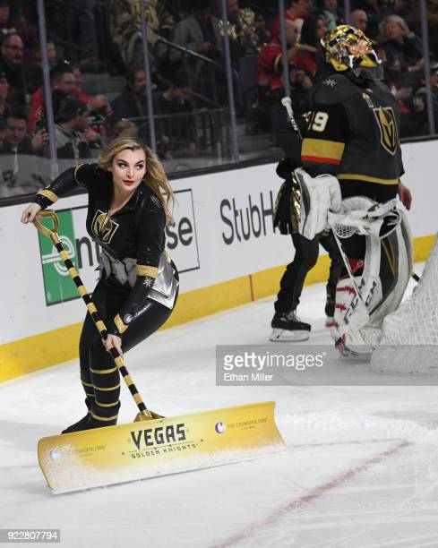A member of the Knights Crew cleans the ice as MarcAndre Fleury of the Vegas Golden Knights stands behind the net during the Golden Knights' game...