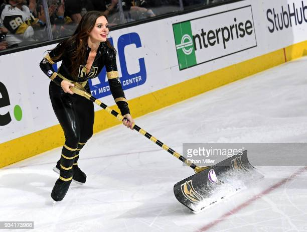 A member of the Knights Crew cleans the ice during the Vegas Golden Knights' game against the Calgary Flames at TMobile Arena on March 18 2018 in Las...