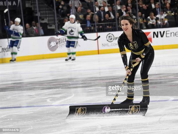 A member of the Knights Crew cleans the ice during the Vegas Golden Knights' game against the Vancouver Canucks at TMobile Arena on March 20 2018 in...