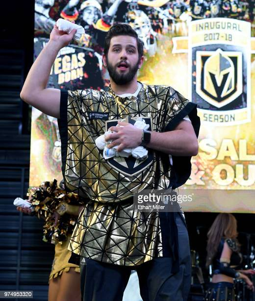 A member of the Knights Crew throws Tshirts to fans during the Vegas Golden Knights' 'Stick Salute to Vegas and Our Fans' event at the Fremont Street...