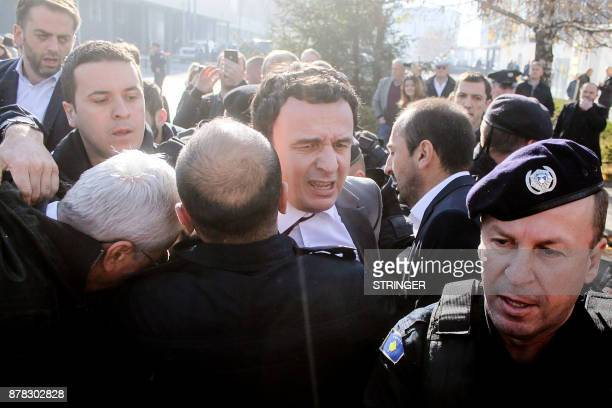 Member of the Kosovo Parliament Albin Kurtistruggles while being detained by Kosovo police on November 24 2017 in Pristina Kosovo police on November...