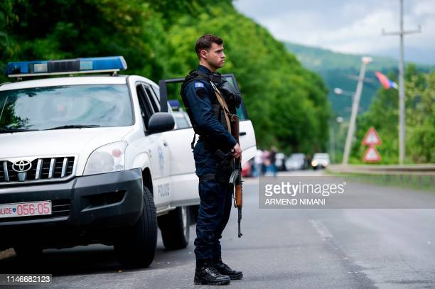 A member of the Kosovo Police Special Unit secures the area near the village of Cabra near the town of Mitrovica on May 28 2019 Kosovo police met...