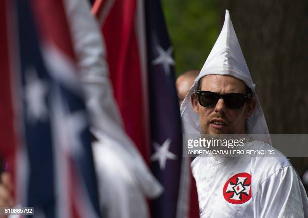 A member of the Ku Klux Klan looks on during a rally calling for the protection of Southern Confederate monuments in Charlottesville Virginia on July...