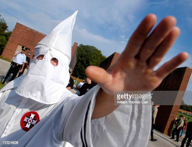 A member of the Ku Klux Klan salutes during American Nazi Party rally at Valley Forge National Park September 25 2004 in Valley Forge Pennsylvania...