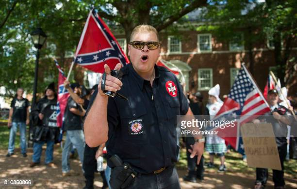 TOPSHOT A member of the Ku Klux Klan shouts at counter protesters during a rally calling for the protection of Southern Confederate monuments in...