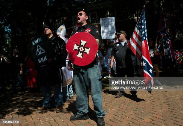 A member of the Ku Klux Klan shouts at counter protesters during a rally calling for the protection of Southern Confederate monuments in...