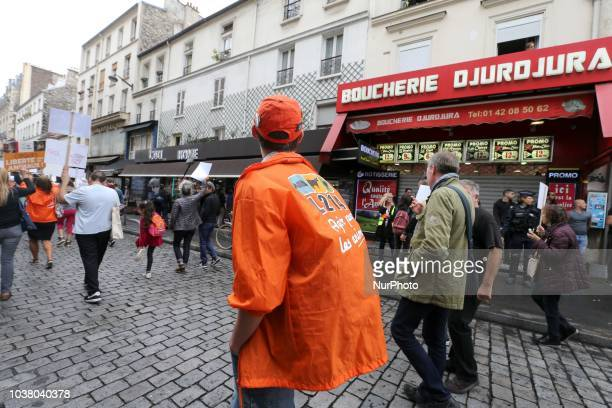 A member of the L214 association protests in front a butcher shop during the 18th Paris Veggie Pride on September 22 2018 in Paris The Paris Veggie...