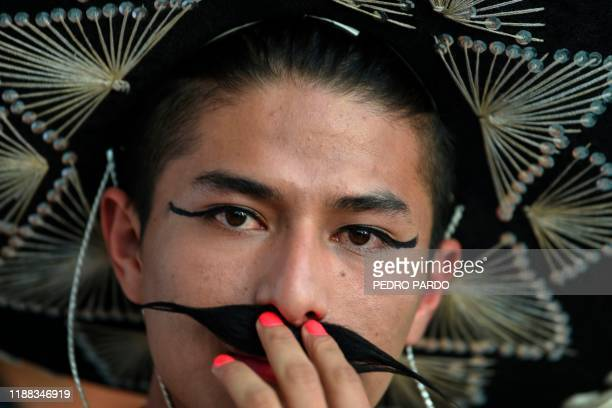 A member of the LBGT community takes part in a demonstration to support Mexican artist Fabian Chairez' painting called 'La Revolucion 2014' part of...
