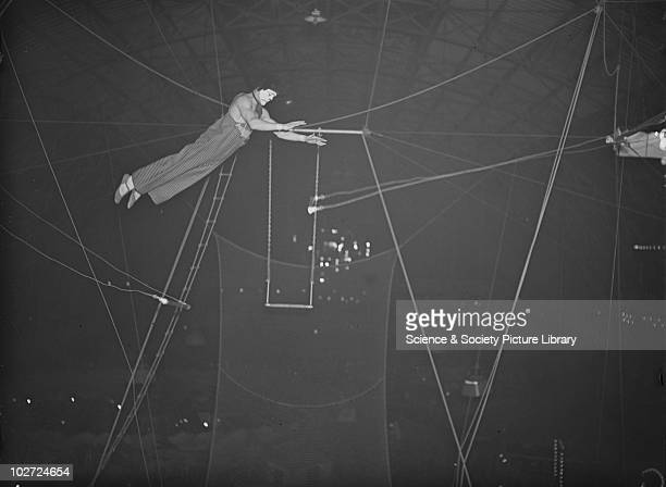 Member of the Leotaris troupe of trapeze artists by Edward George Malindine1936 A photograph of a member of the Leotaris troupe of trapeze artists...