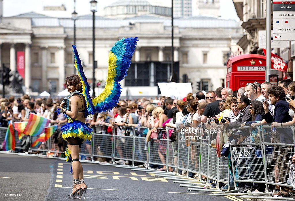 A member of the Lesbian, Gay, Bisexual and Transgender (LGBT) community parades through central London during the annual Pride Parade on June 29, 2013.