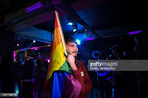 TOPSHOT A member of the LGBT community goes emotional in a club as community members wait for the results of a referendum in Bucharest Romania on...