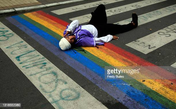 Member of the LGBTQI community performs during a protest to denounce violence against LGBTQI community on May 17, 2021 in Medellin, Colombia.