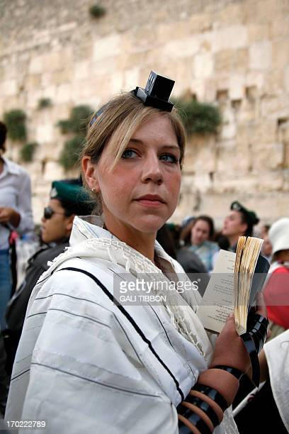 A member of the liberal Jewish religious group Women of the Wall wears phylacteries and the Tallit shawl traditional Jewish prayer apparel for men as...